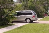 Mini Van parked blocking sidewalk picture