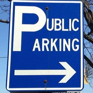 "A blue sign that reads, ""Public Parking"" in white print."